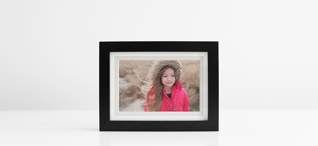 framed image of a girl with long hair printed on photo paper