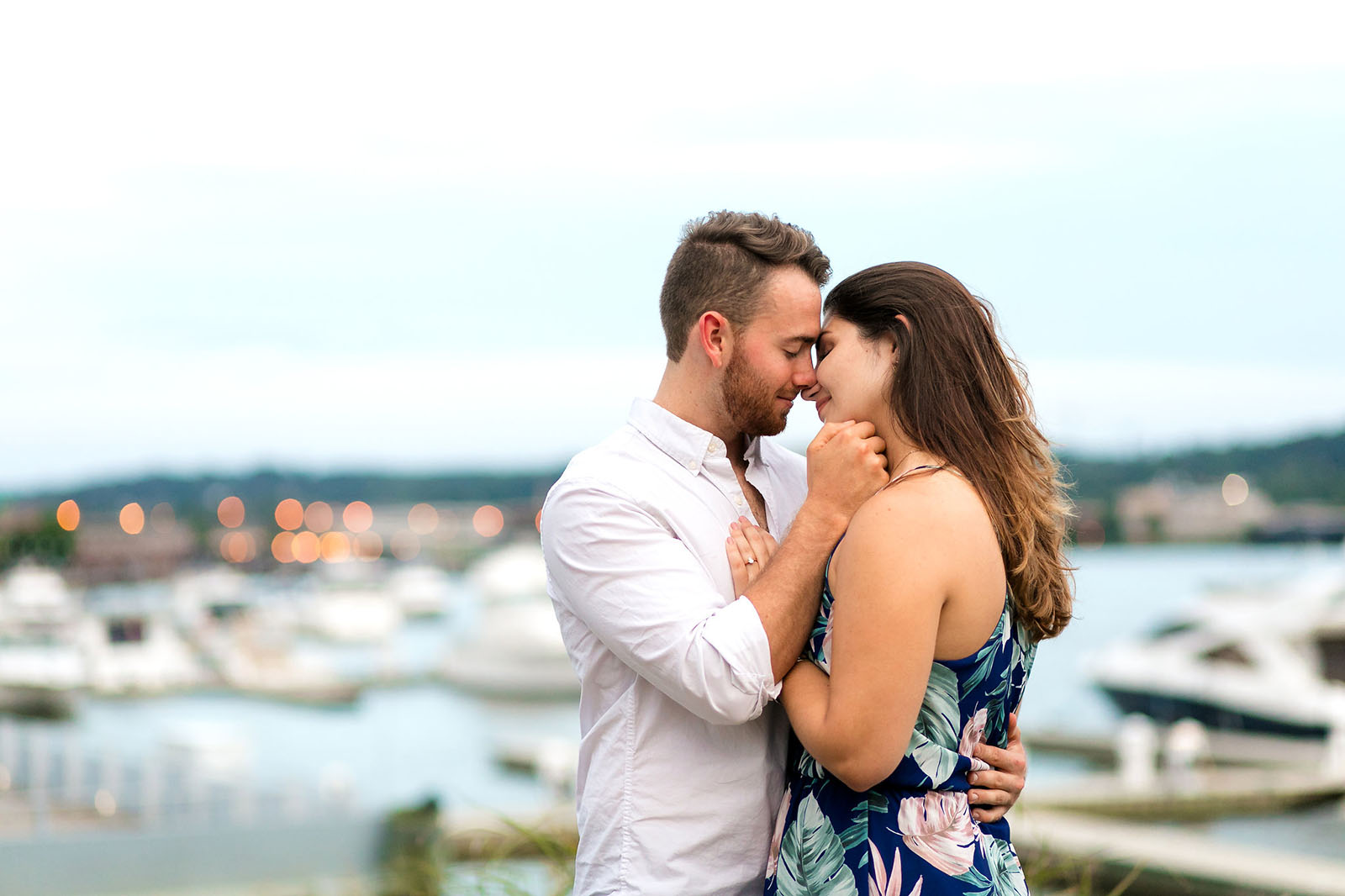 Couple kissing at engagement session, photography pricing