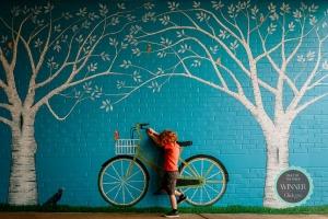 Small Icon-Amanda-Barrick-redhead-boy-with-wall-art-bicycle