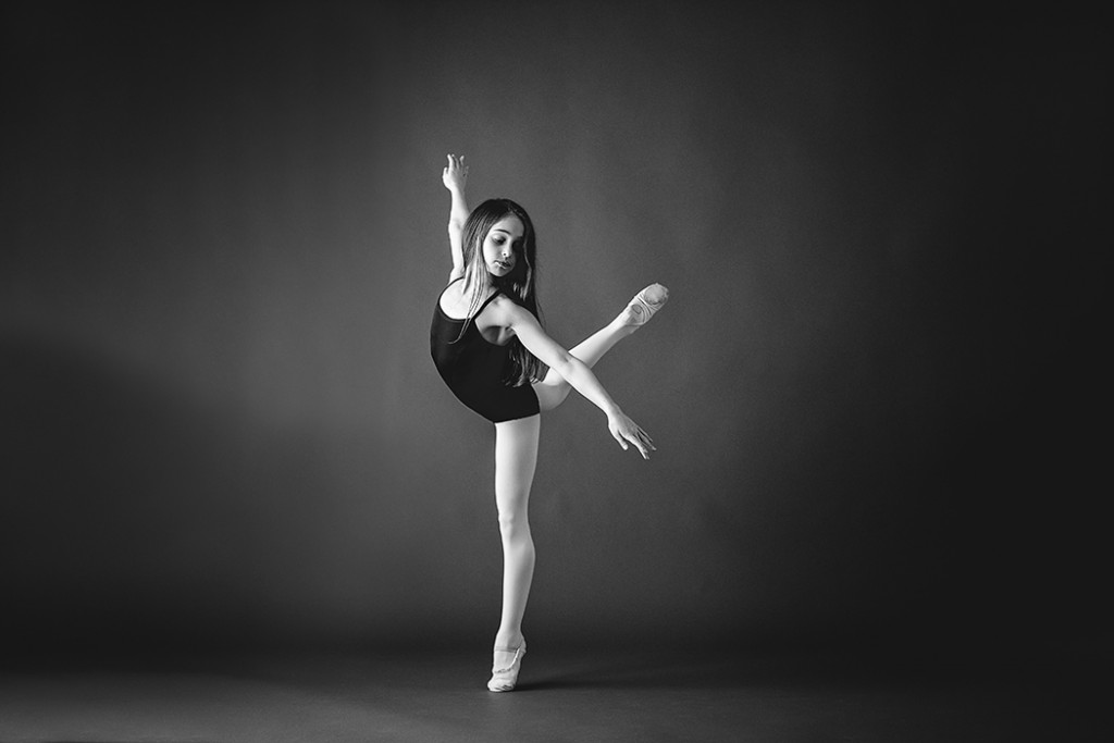 black and white photo of girl ballet dancing by Faye Sevel