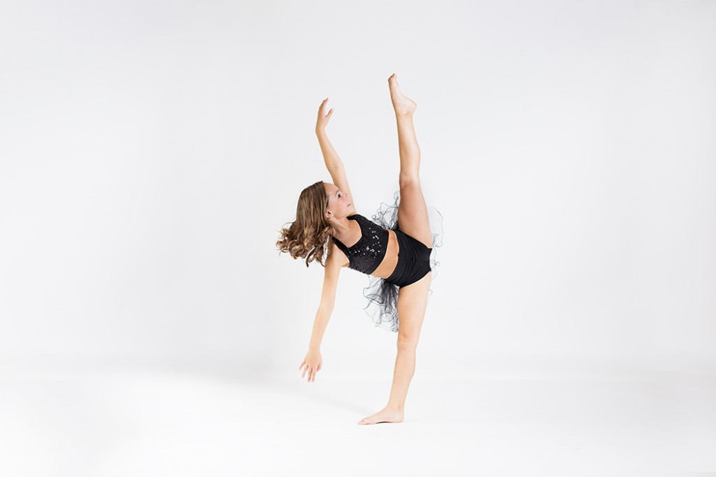 dance photo of girl in black outfit by Faye Sevel