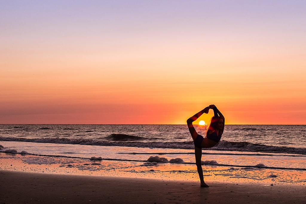 girl dancing on the beach at sunset by Faye Sevel