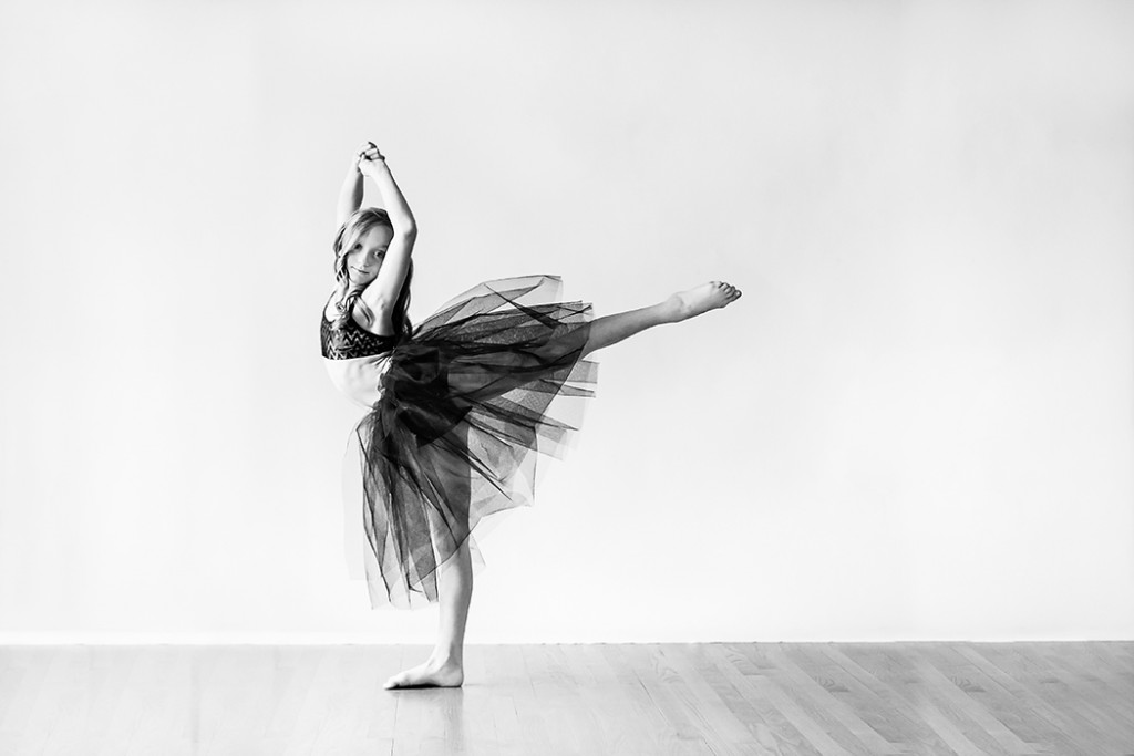 girl wearing a tutu and dancing ballet by Faye Sevel