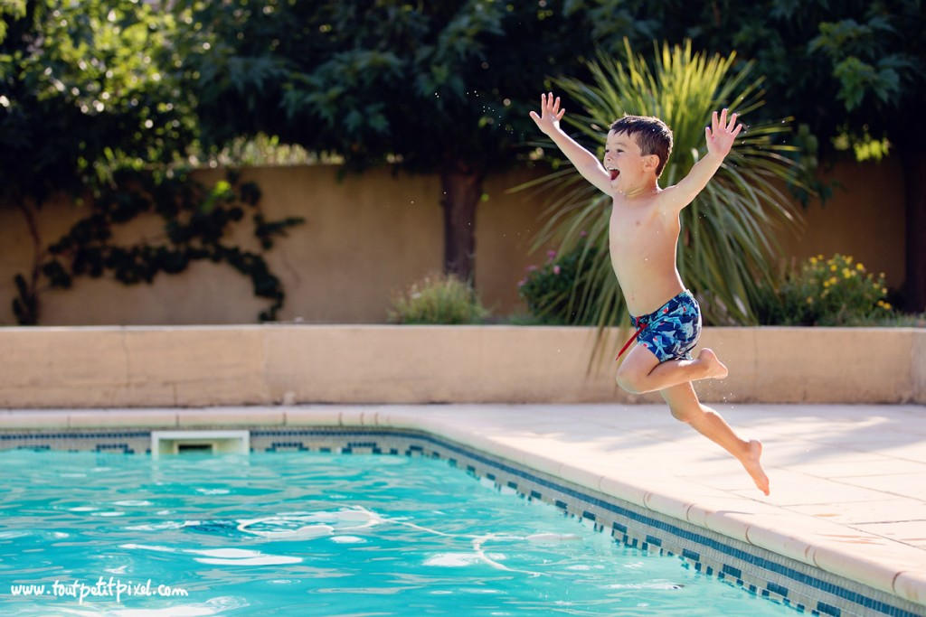 happy pic of kid jumping into a swimming pool by Lisa Tichane 5