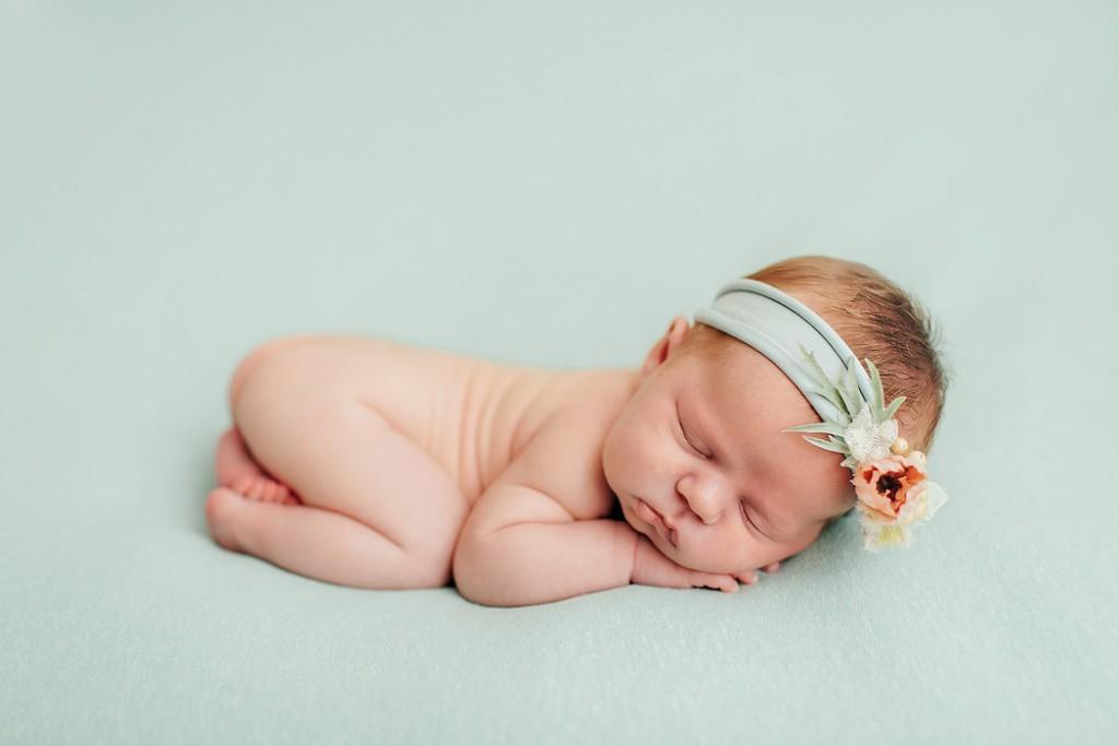 newborn photo on a blue blanket by Winnie Bruce