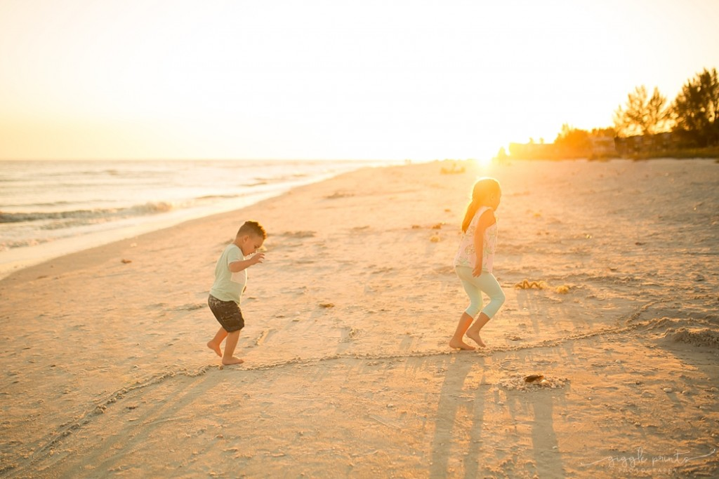 photo of a brother and sister walking on the beach by Marcie Reif