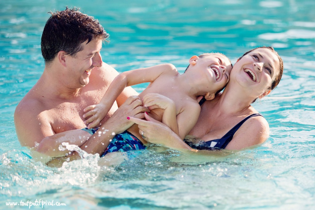 photo of family playing in the pool and laughing by Lisa Tichane 6
