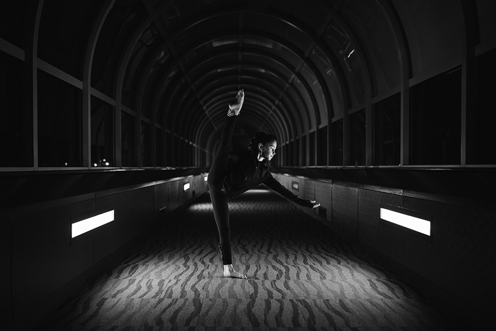 photo of girl dancing down a hallway by Faye Sevel