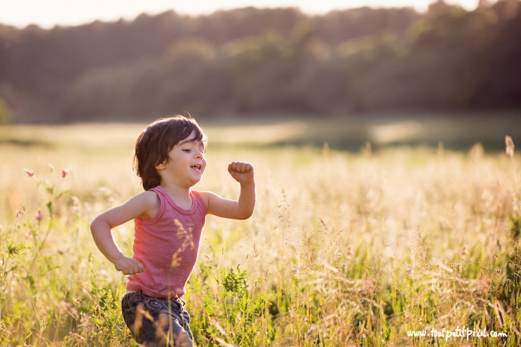 photo of kid running in a field by Lisa Tichane 2