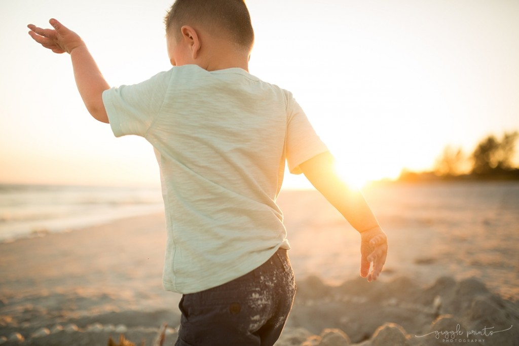 picture of boy playing on the beach by Marcie Reif