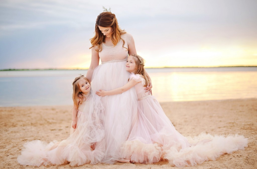 picture of mom and two daughters on the beach by Woodsy Wonders Photography