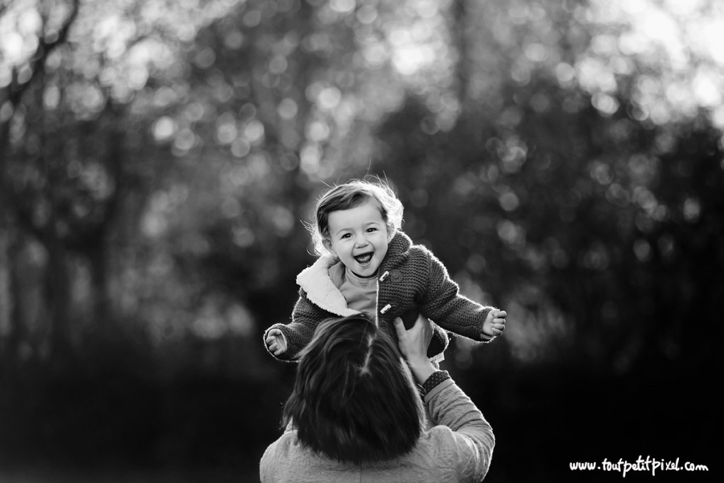 portrait of mom holding daughter up in the air by Lisa Tichane 1