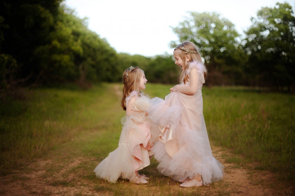 two girls in matching dresses in a field by Woodsy Wonders Photography