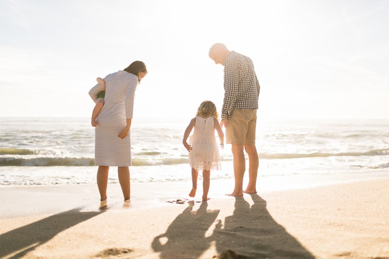 backlit family portrait on the beach by Kristin Dokoza