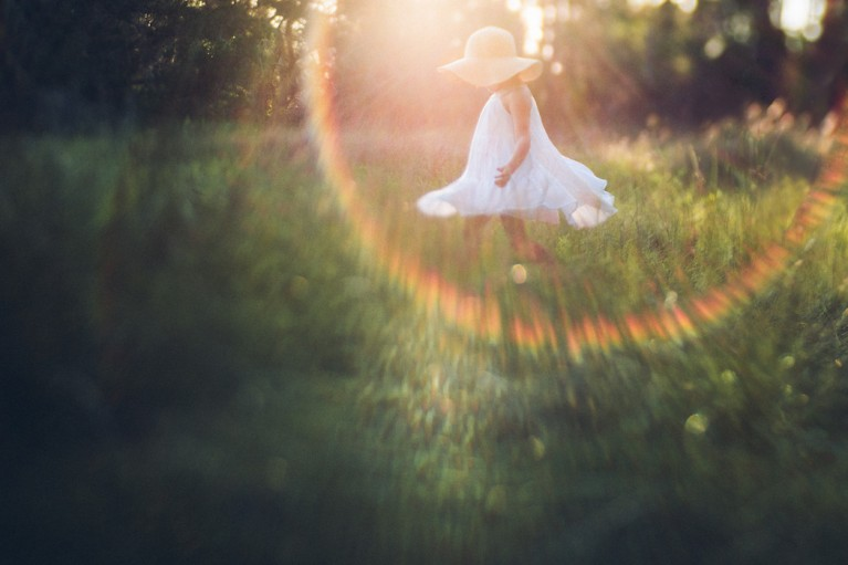 backlit photo with rainbow sunflare by Monika Colichio