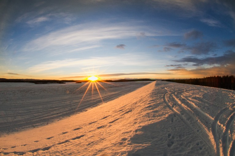 landscape photo of Alaska covered in snow by Charlaine Williams