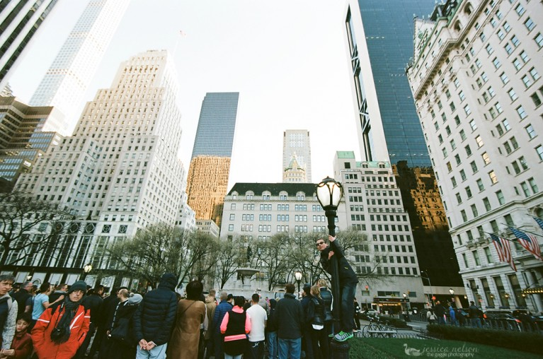 people standing in a downtown setting by Jessica Nelson