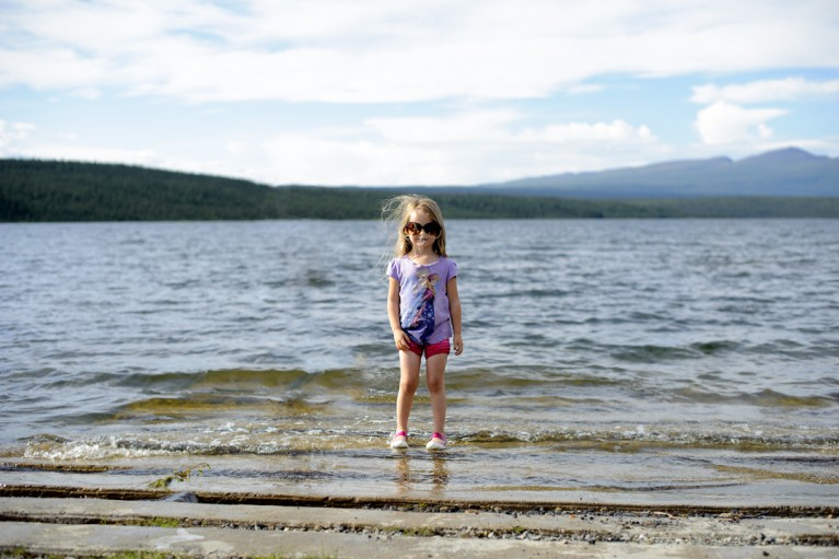 photo of girl standing on a beach in Alaska by Charlaine Williams