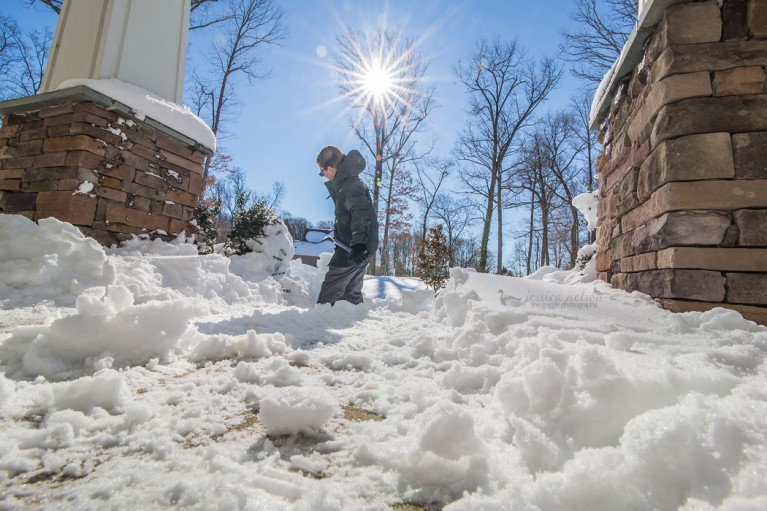 picture of boy shoveling snow by Jessica Nelson
