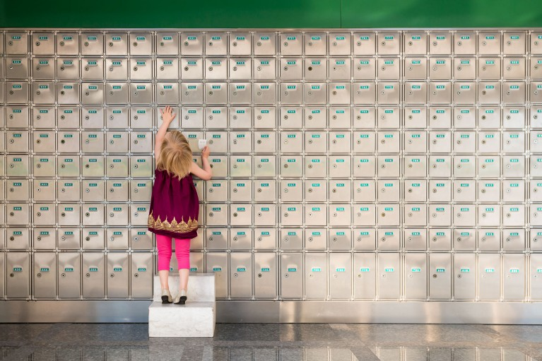 picture of young girl checking the mail at the post office by Rebecca Hunnicutt Farrin