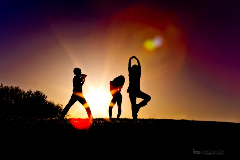 silhouette picture of 3 siblings by Jessica Nelson