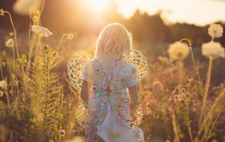 backlit photo of girl wearing DIY wings by Amy Lockheart