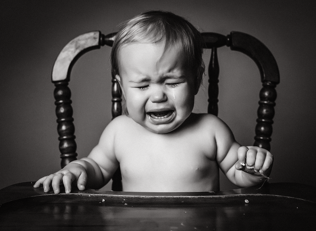 black and white picture of kid crying by Kate Luber