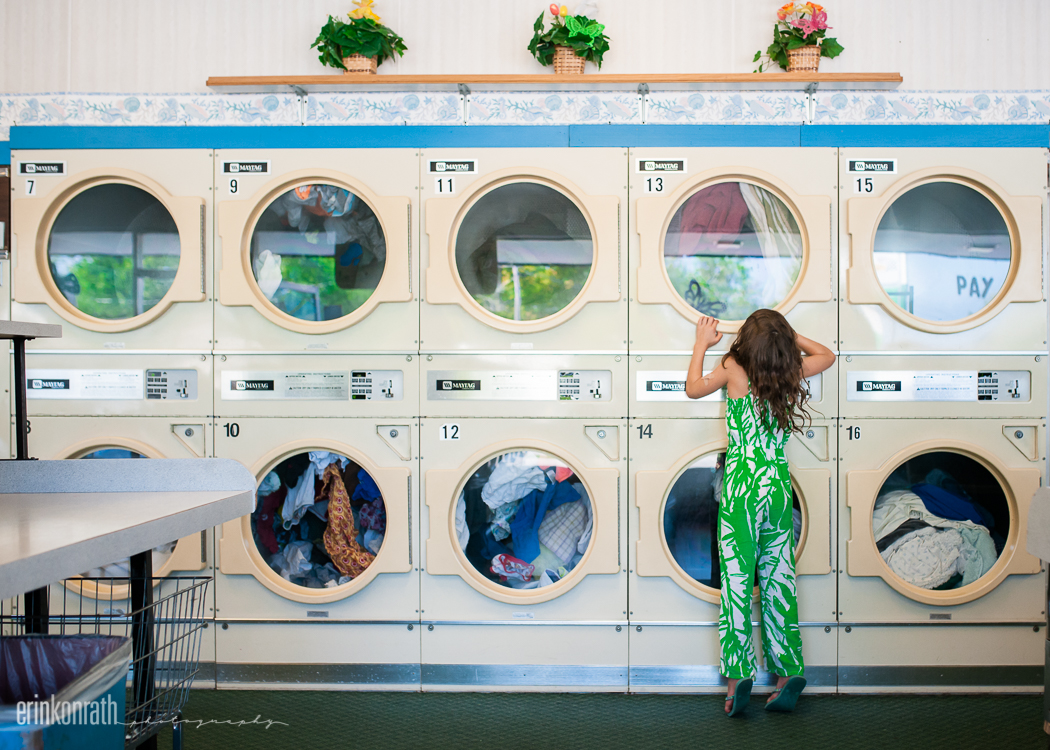 photo of girl checking laundry at the laundromat by Erin Konrath