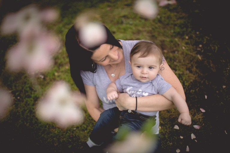 photo of mom holding child by Cambria Bailey
