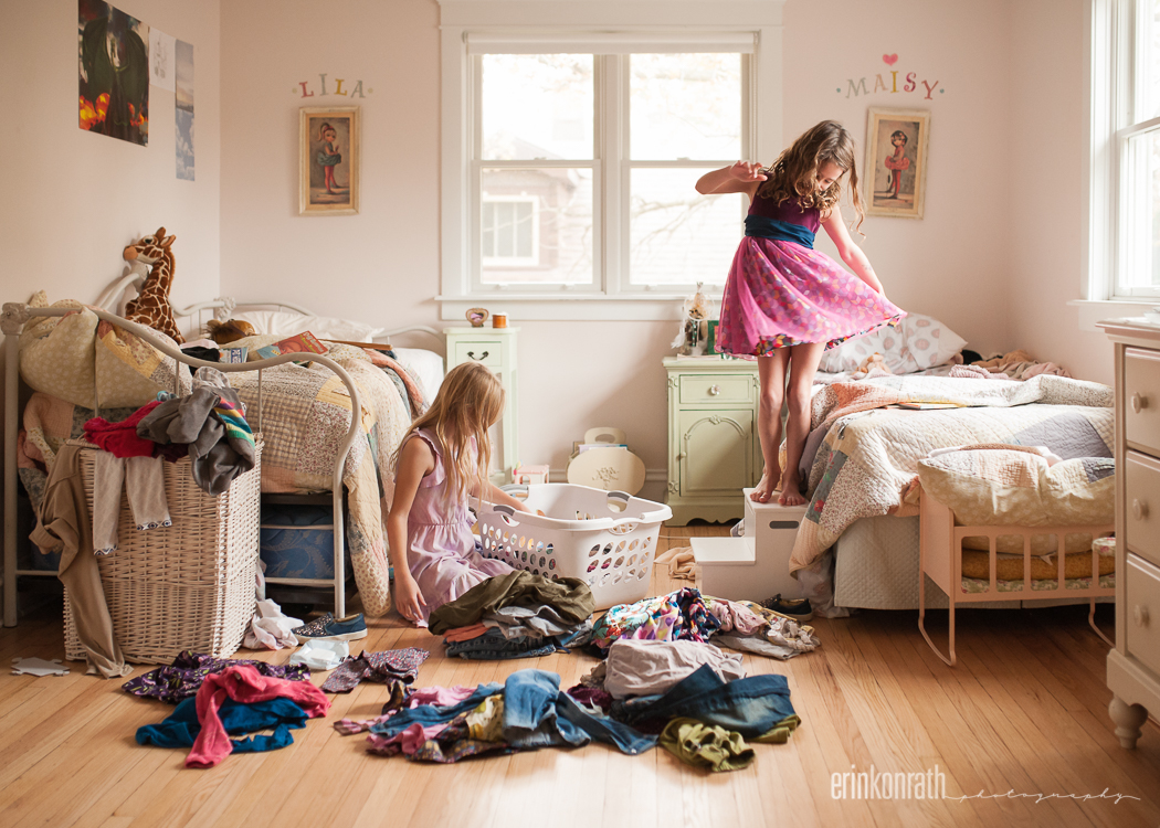 photo of two girls trying on clothes in their room by Erin Konrath
