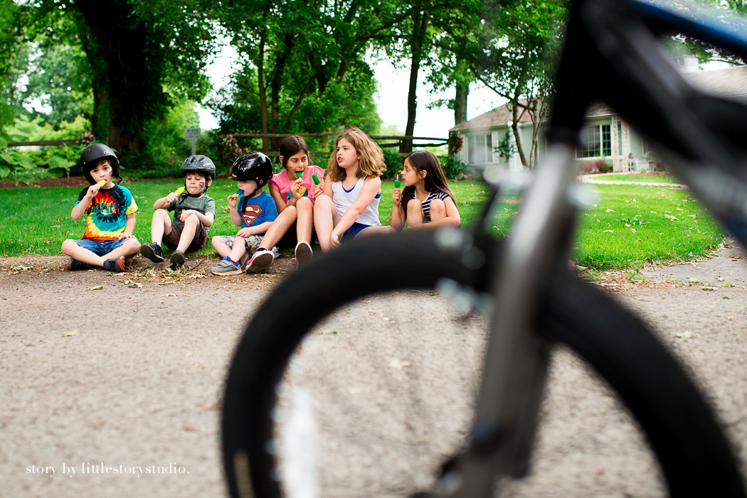 photograph of kids talking and eating by Andrea Moffatt