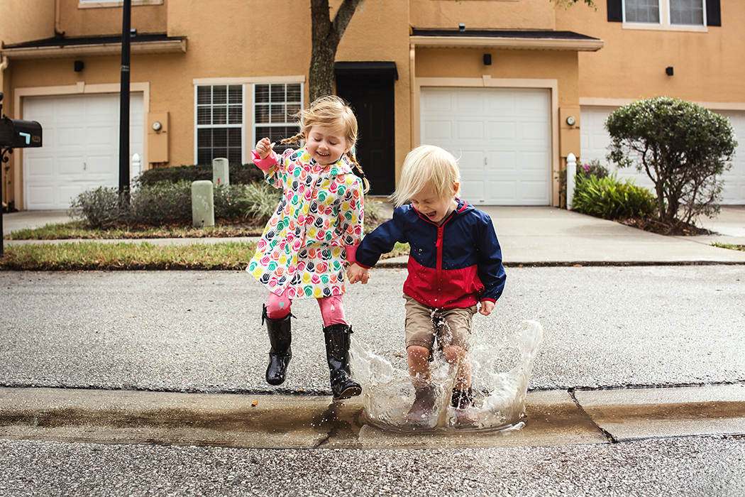 pic of two kids jumping in a water puddle by Jennifer Kielich