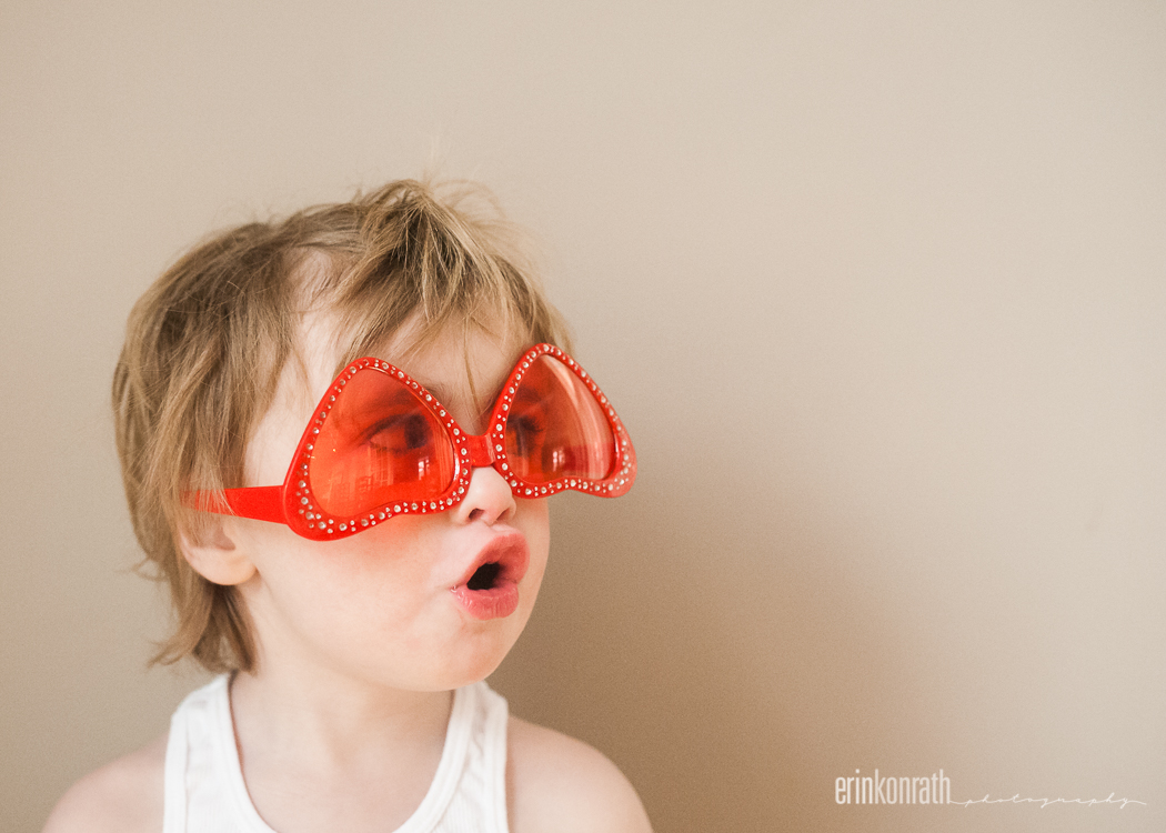 picture of kid in upside down heart glasses by Erin Konrath