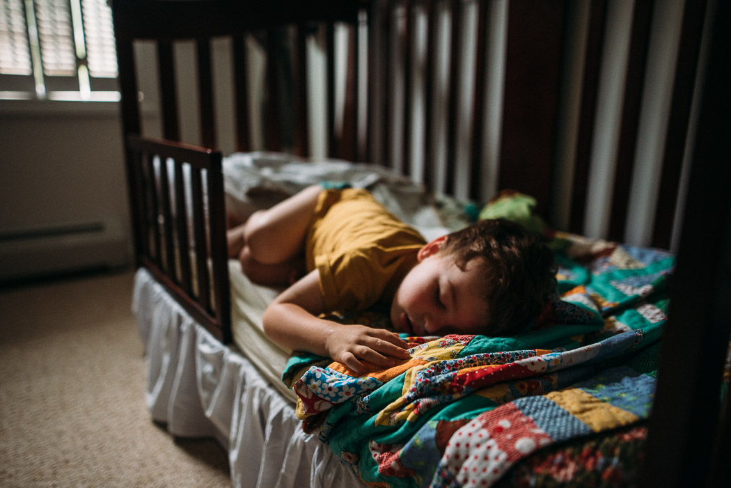 picture of kid sleeping in toddler bed by Elise Meader