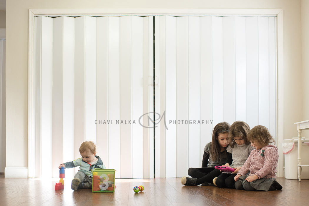 picture of kids playing in living room by Chavi Malka