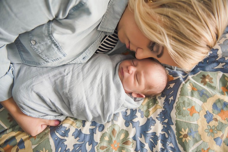 picture of mom snuggling newborn by Erin Schmidt