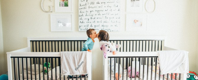 picture of two toddlers in their cribs by Elise Meader