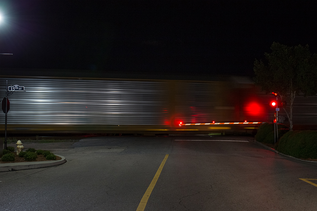 slow shutter photo of train by Jamie Campfield Bates