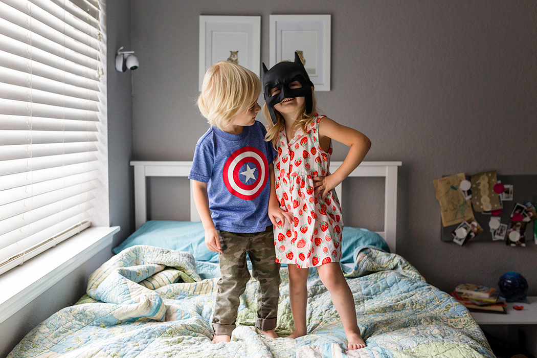 two kids wearing batman and captain america clothes by Jennifer Kielich