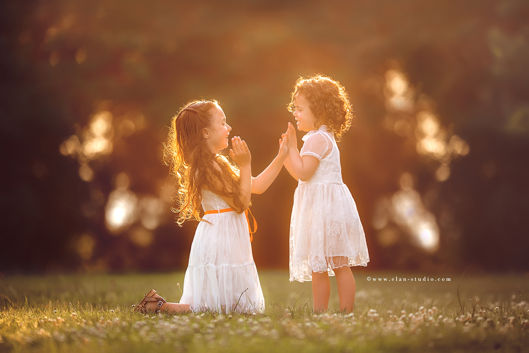 backlit photo of girls playing by Tracy Sweeney of Elan Studio