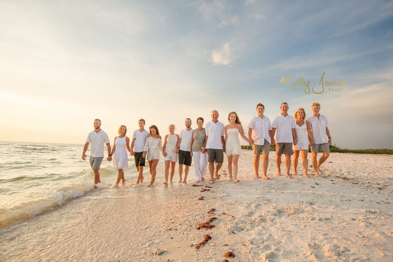 extended family group portrait on the beach by Kelly Jones