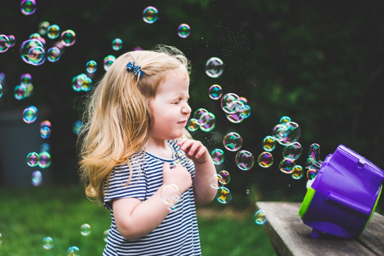 photo of bubbles blowing in girls face by Francesca Russell
