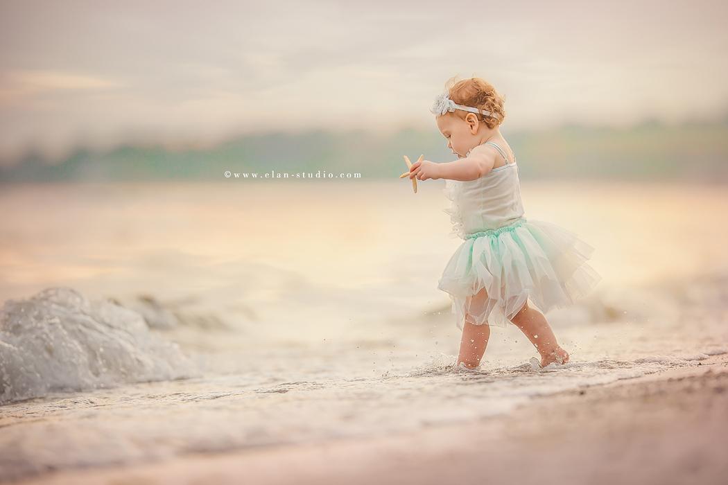 photo of girl walking into the water by Tracy Sweeney of Elan Studio