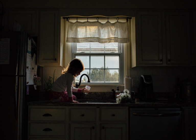 picture of child filling a cup with water by Rachel McCalley