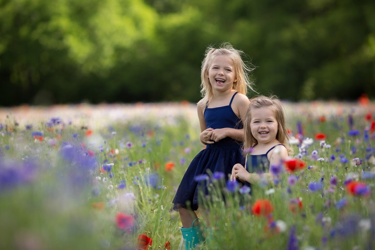 picture of two girls in a field of flowers by Eliz Alex Photography
