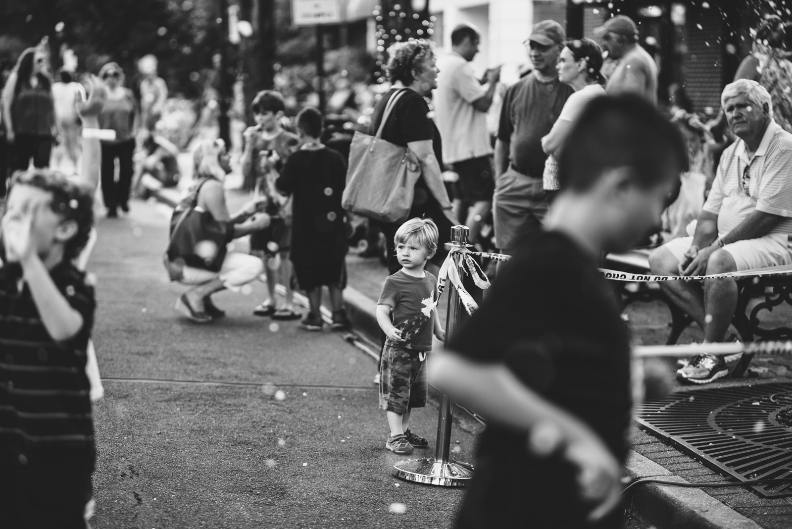 black and white photo of kids on the street by Francesca Russell