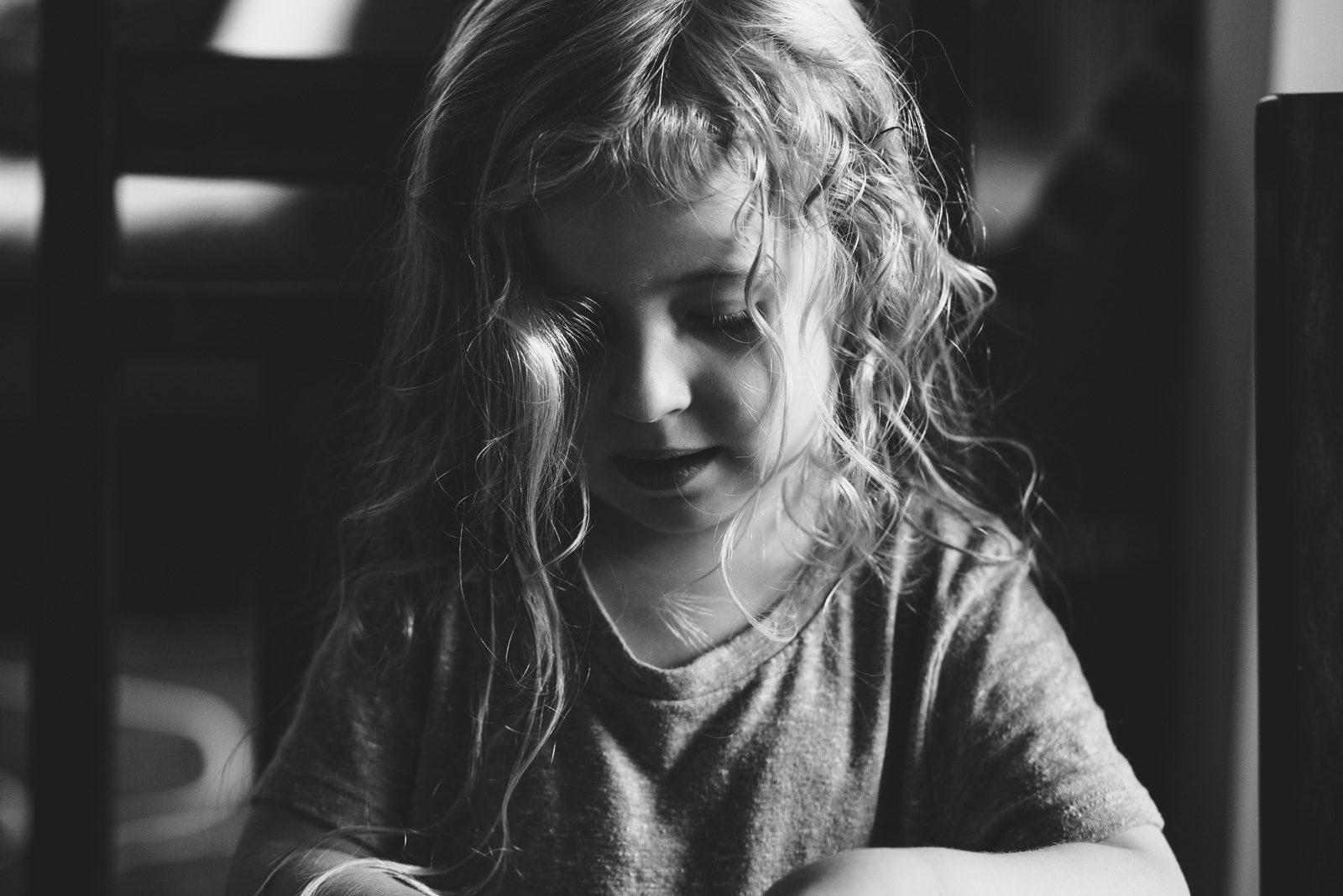 black and white photo of young girl with curly hair by Francesca Russell