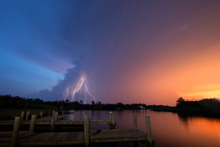 lightning photo at sunset near the lake by Jamie Campfield Bates