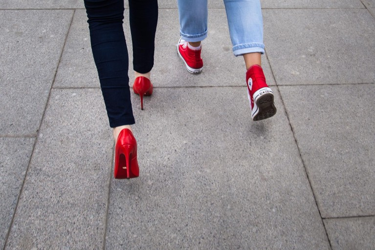 photo of two people walking in red shoes by Nina Mingioni