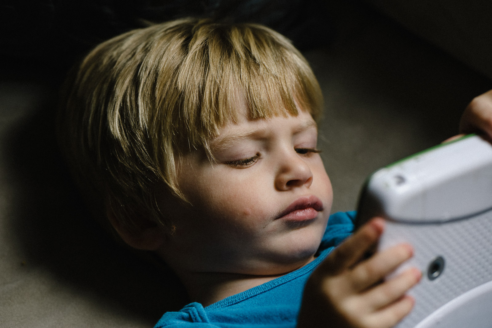 pic of boy playing a game by Francesca Russell